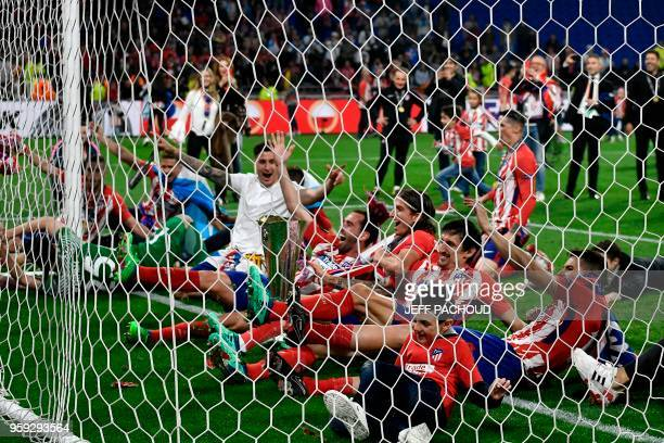 TOPSHOT Atletico's players celebrate with the trophy after the UEFA Europa League final football match between Olympique de Marseille and Club...