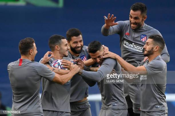 Atletico's players joke during a training session at the Jose Alvalade stadium in Lisbon on August 12, 2020 on the eve of the UEFA Champions League...