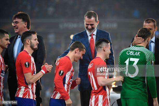 TOPSHOT Atletico's players receive their winners medals after the UEFA Europa League final football match between Olympique de Marseille and Club...