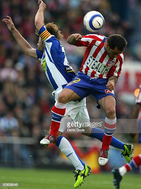 Atletico's Sergi Barjuan tussles with Espanol's Garcia during the La Liga match between Atletico Madrid and Espanol at the Calderon on April 16 2005...