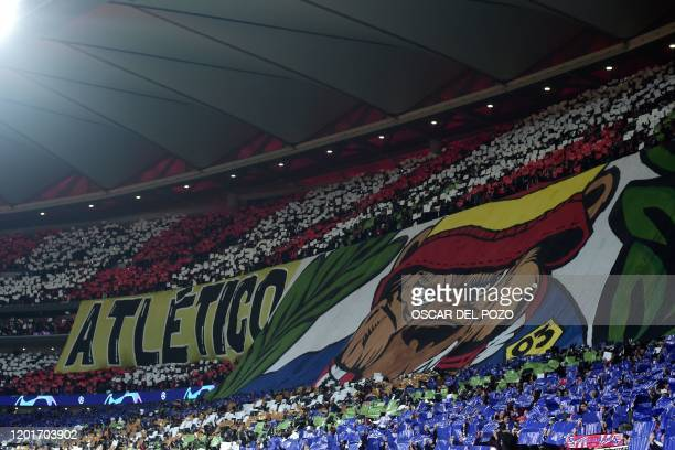 Atletico's supporters cheer their team before the UEFA Champions League round of 16 first leg football match between Club Atletico de Madrid and...
