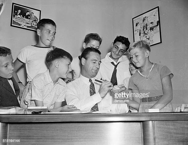 Atley Donald Yankee pitcher Lou Gehrig former Yankee first sacker and Bill Dickey all help the kids with their baseball homework at the Court of...