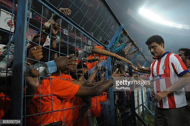 Atl��tico de Kolkata CoOwner and Former Indian Cricket Team Captain Sourav Ganguly shake hand her team fans during the Indian Super League Match 31...