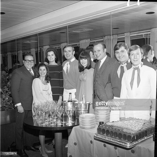 Atmosphere and attendees pose for portraits at a performance by the folk group The New Christy Minstrels at the Rainbow Room on December 9 1968 in...