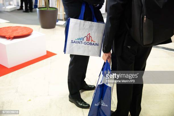 Atmosphere as French building materials giant SaintGobain shareholders arrive to attend the group's general meeting on June 7 2018 in Paris France...