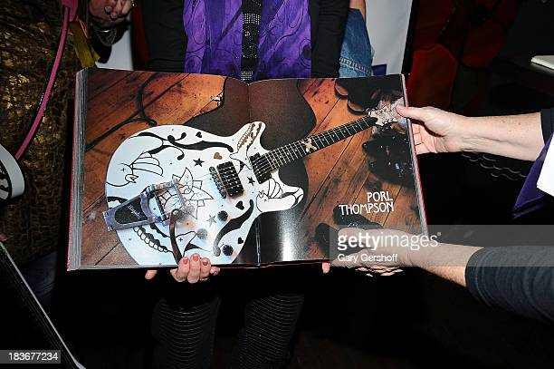 Atmosphere at the book launch and performance for '108 Rock Star Guitars' benefitting The Les Paul Foundation at The Cutting Room on October 8 2013...