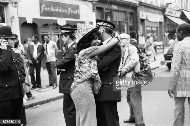 Atmosphere at the Notting Hill Carnival Twentyyearold Joanna Edward from Dominica enjoys dancing with all the ranks of the police force 29th August...