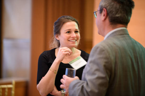 Fotos und Bilder von Options Group People Science Breakfast