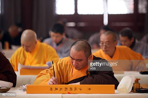 Atmosphere during the 'Ten Thousand People Copy Confucian Classics' launching ceremony on Dragon Headsraising Day on March 21 2015 in Zhengzhou Henan...