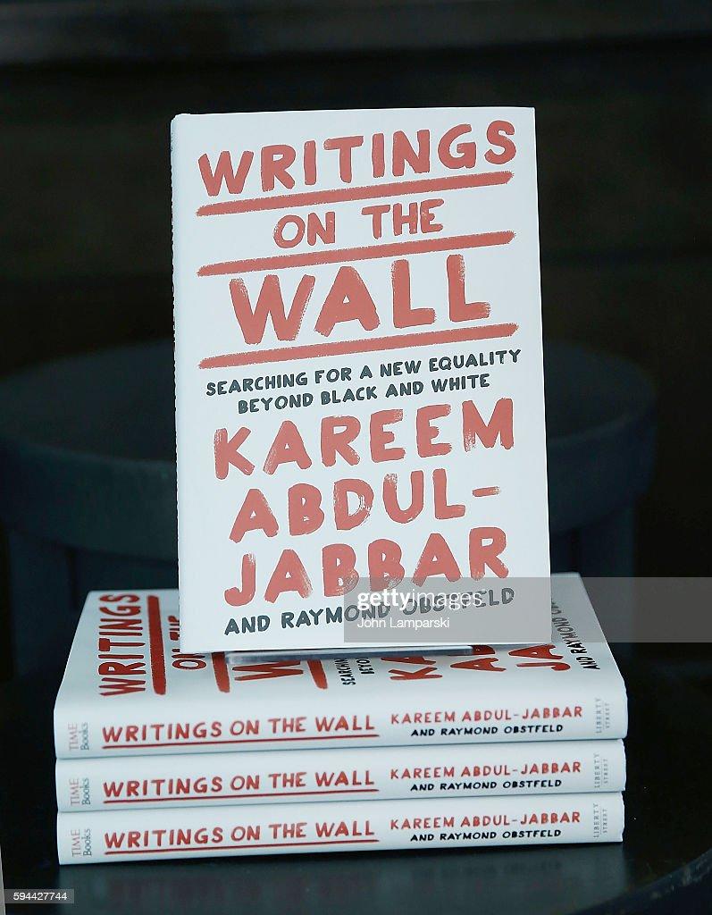 Former NBA pplayer, Kareem Abdul-Jabbar signs copies of 'Writings on the  Wall