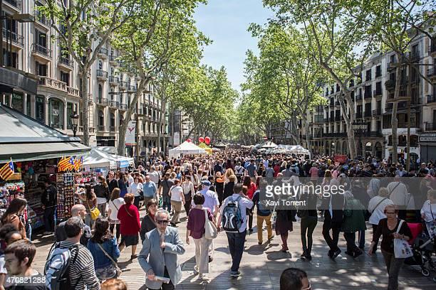 Atmosphere in Las Ramblas at Sant Jordi's day on April 23 2015 in Barcelona Spain