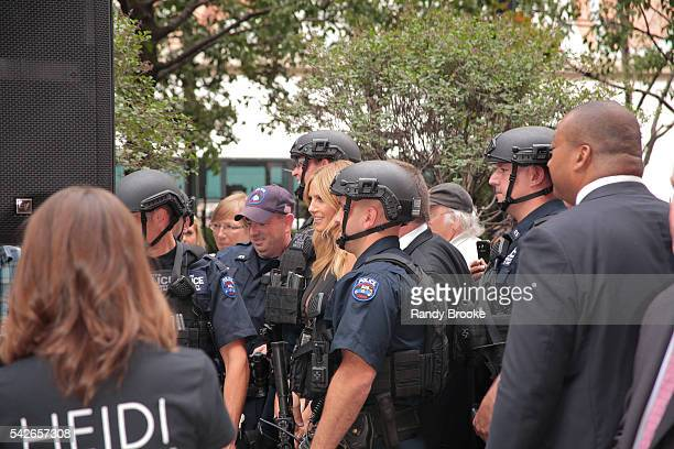 Atmosphere of Heidi Klum posing with New York City police just before the start of the Heidi Klum Hosts Lingerie Party at Macy's Herald Square on...