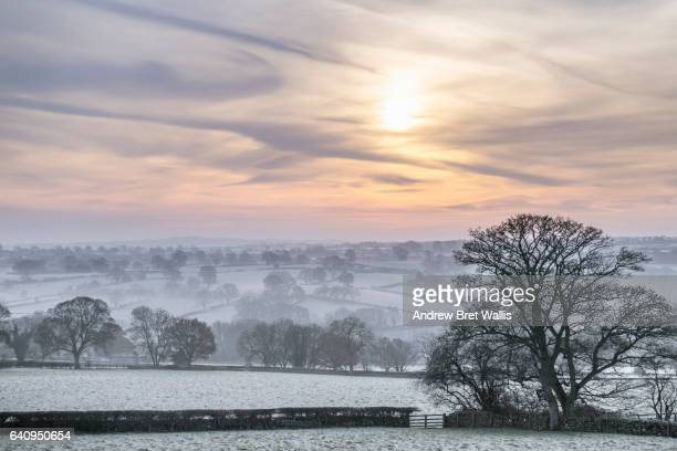 atmospheric mist covers the valley floor in rural north yorkshire - fog stock pictures, royalty-free photos & images