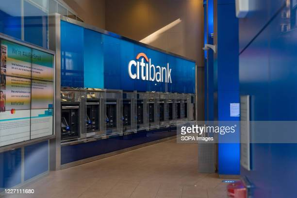 ATMs at Citibank branch of Citigroup are seen in New York. Profit plummeted at the bank because of COVID-19 pandemic. Citibank is expected to reveal...
