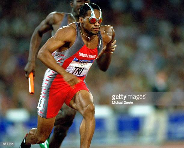 Ato Boldon of Trinidad and Tobago wears Oakley sunglasses September 29, 2000 during the men's 4x100m relay semi-finals at the Olympic Stadium on day...