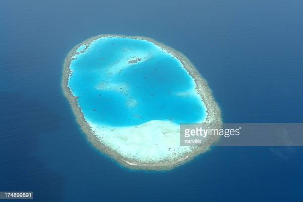 atoll in indian ocean from bird's eye view - atoll stock pictures, royalty-free photos & images