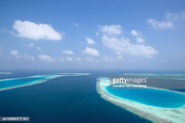 atolls and coral reefs, aerial view - atoll stock pictures, royalty-free photos & images