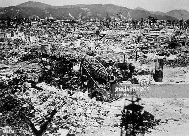 Atomic bomb damage at Hiroshima with a burnt out fire engine amidst the rubble