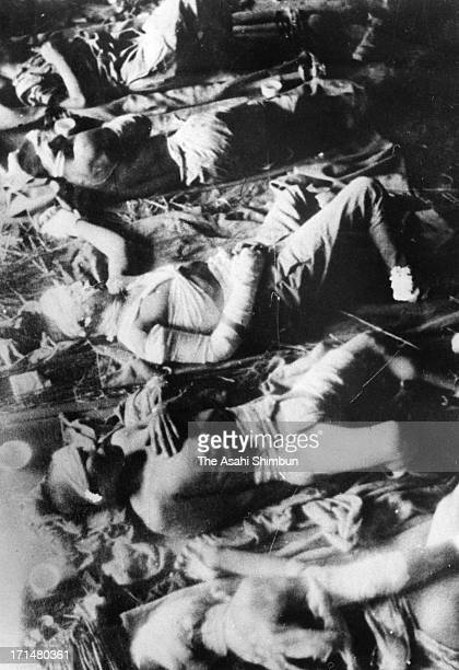 Atomic bomb survivors lie on the floor, waiting for receive treatment at temporary hospital set at Fukuya Department Store in August 1945 in...