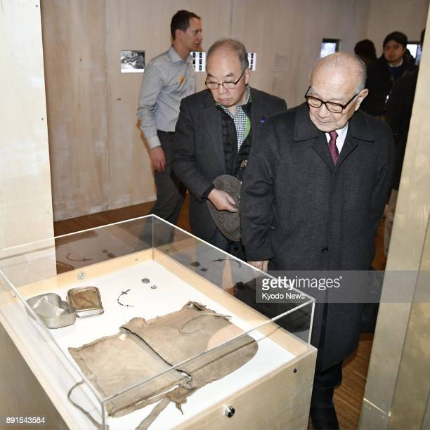 Atomic bomb survivors Terumi Tanaka and Toshiki Fujimori view belongings left by the victims of the Hiroshima and Nagasaki atomic bombings displayed...