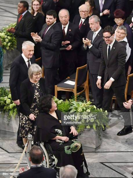 Atomic bombing survivor Setsuko Thurlow is applauded on her way out after the Nobel Peace Prize award ceremony by those in the audience including...