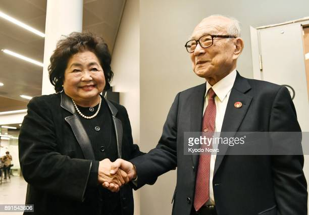 Atomic bombing survivors Setsuko Thurlow and Terumi Tanaka shake hands after a press conference in Oslo on Dec 12 2017 They came to the Norwegian...