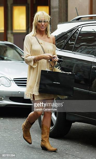 Atomic Kitten singer Jenny Frost goes shopping on April 28, 2004 in Central London.