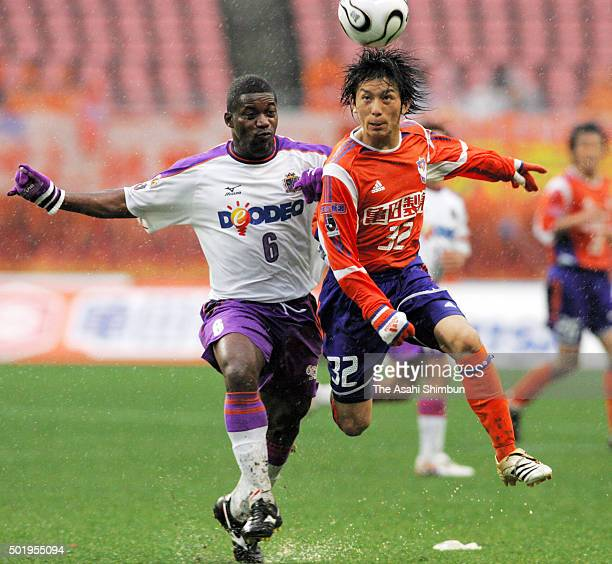 Atomu Tanaka of Albirex Niigata and Beto of Sanfrecce Hiroshima compete for the ball during the Albirex Niigata and Sanfrecce Hiroshima at Niigata...