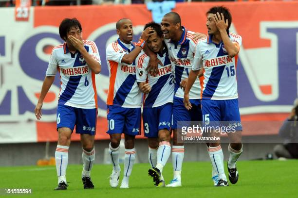 Atomu Tanaka of Albirex Niigata celebrates the first goal with his team mates Isao Honma Michael Jefferson Nascimento Bruno Da Silva Lopes and Yuta...
