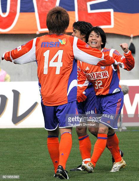 Atomu Tanaka of Albirex Niigata celerbates scoring his team's third goal during the JLeague match between Ventforet Kofu and Albirex Niigata at...