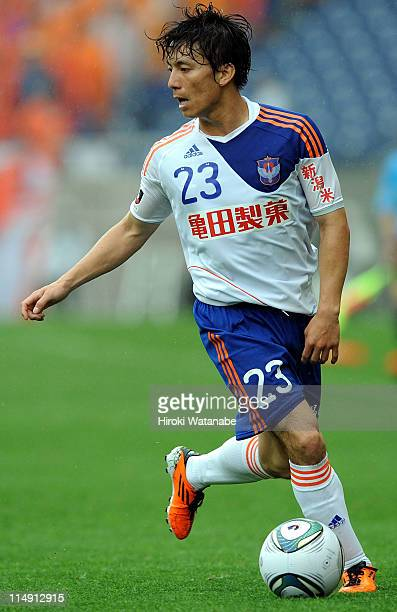 Atomu Tanaka of Albirex Niigata in action during JLeague match between Urawa Red Diamonds and Albirex Niigata at Saitama Stadium on May 28 2011 in...