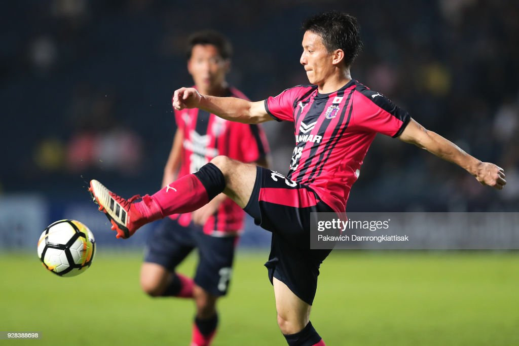 Atomu Tanaka #32 of Cerezo Osaka (R) tries to control the ball during the AFC Champions League Group G match between Buriram United Football Club and Cerezo Osaka at Thunder Castle on March 6, 2018 in Buriram, Thailand.