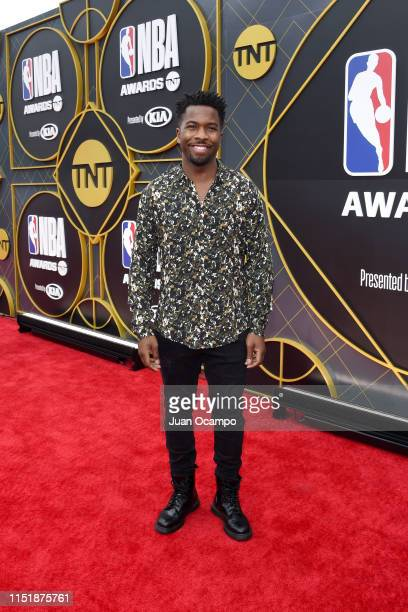 Ator Jean Elie poses for a portrait on the red carpet before the 2019 NBA Awards Show on June 24 2019 at Barker Hangar in Santa Monica California...