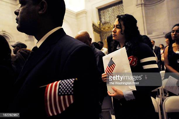 Atra Osman of Ethiopia left and Flor Silva of El Salvador right are seen during a naturalization ceremony of 215 people on the 225th anniversary of...
