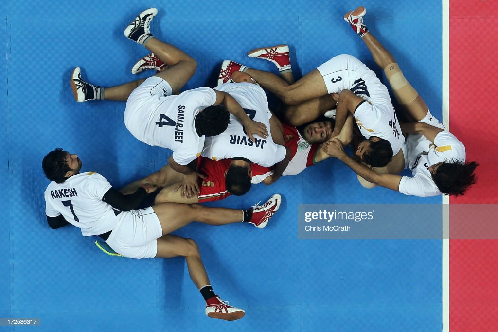 Atrachali Fazel #5 of Iran is tackled by the Independent Olympic Athletes defence during the Men's Kabaddi Gold Medal match at Ansan Sangnoksu Gym on day five of the 4th Asian Indoor & Martial Arts Games on July 3, 2013 in Incheon, South Korea.