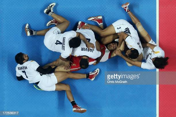 Atrachali Fazel of Iran is tackled by the Independent Olympic Athletes defence during the Men's Kabaddi Gold Medal match at Ansan Sangnoksu Gym on...