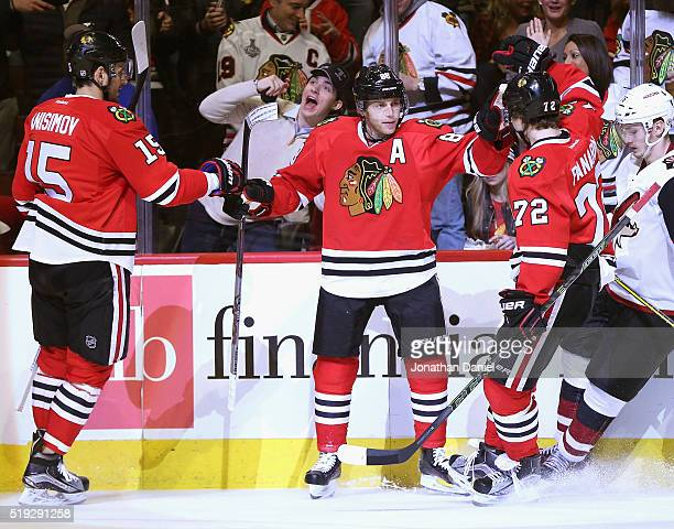 Atrem Anisimov Patrick Kane and Artemi Panarin of the Chicago Blackhawks celebrate a second period goal by Kane against the Arizona Coyotes at the...