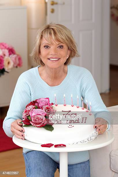 Atress Uschi Glas poses with a birthday cake prior to her 70th birthday on February 24 2014 in Munich Germany The acctress turns 70 on March 2nd