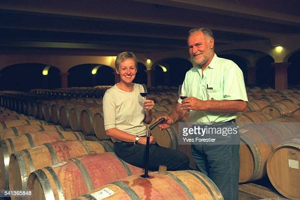 B{atrice and Jacques tasting their production among the 3800 barrels stored in their wine storehouse