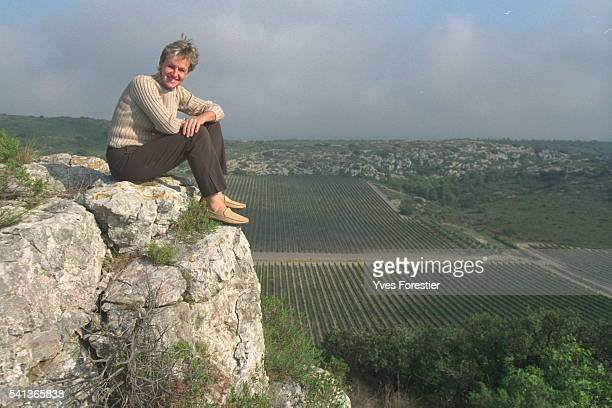 B{atrice BuyckRibourel seated on the 'winegrow er's bench' that overlooks the Hospitalet estate