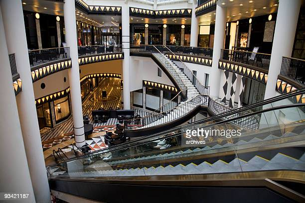 atrium of a mall with multiple stairs and escalators - central berlin stock pictures, royalty-free photos & images