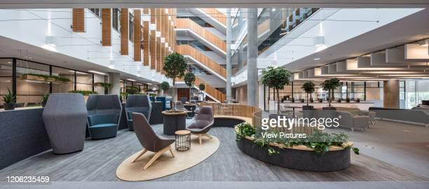 Atrium sitting area. YOOX Net-A-Porter Offices, London, United Kingdom. Architect: Grimshaw, 2017.