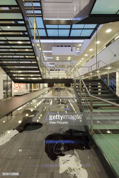 Atrium with water feature and main staircase seen from ground floor at dusk IBC Kolding Campus Kolding Denmark Architect schmidt hammer lassen...