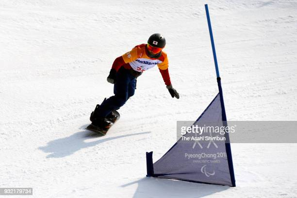 Atsuhsi Yamamoto competes in the Snowboard Men's Snowboard Cross SBLL1 qualification on day three of the PyeongChang 2018 Paralympic Games on March...
