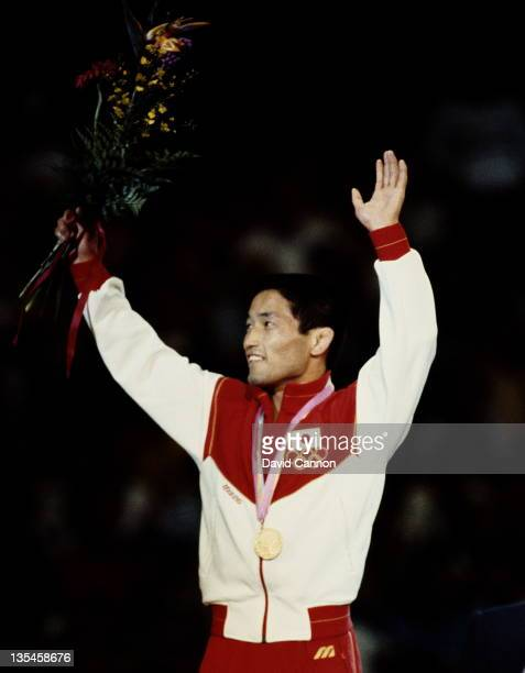 Atsuji Miyahara of Japan celebrates winning the gold medal in the Men's Flyweight GrecoRoman Wrestling event on 10th August 1984 during the XXIII...
