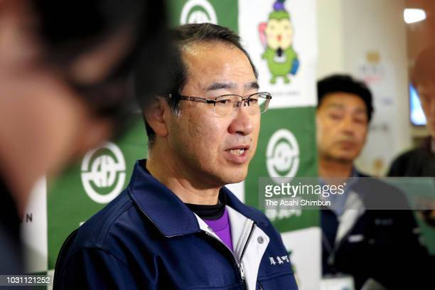 Atsuma City Mayor Shoichiro Atsuma speaks to media reporters at Atsuma City Hall on September 10 2018 in Atsuma Hokkaido Japan Commuters hit the...