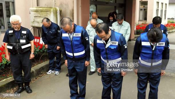 Atsuma City Mayor Shoichiro Miyasaka and city staffs observe a minute of silence at Atsuma City Hall a week after the magnitude 67 earthquake on...