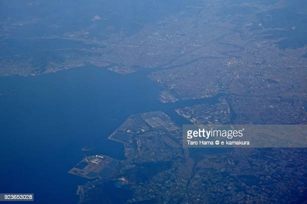 Atsumi Bay and Toyohashi city in Aichi prefecture in Japan daytime aerial view from airplane