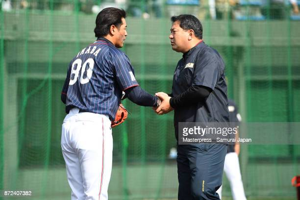 Atsunori Inaba and Tsutomu Ito of Samurai Japan shake hands during a Japan training session on November 10, 2017 in Miyazaki, Japan.