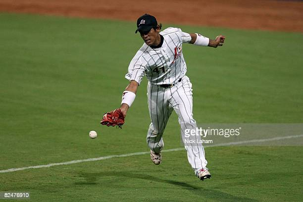 Atsunori Inaba of Japan cannot catch up to foul ball from the United States at the Wukesong Baseball Field during Day 12 of the Beijing 2008 Olympic...